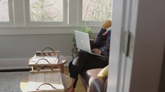 Full tracking shot of a young lady working on a laptop Stock Footage