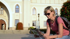 Woman tourist enjoying a view of a old city square Stock Footage