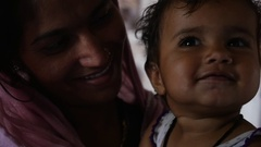 Mother and daughter in a small village in India Stock Footage