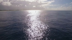 Aerial shot of sailing yacht in bright sunlight Stock Footage