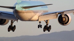 Huge airplane landing on runway view from behind slow motion Stock Footage
