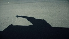 Shadow of man who leaned out of the car Stock Footage