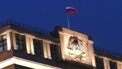 Russian flag on the State Duma in Moscow evening Stock Footage