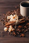 Composition  cup with coffee beans on black background Stock Photos