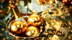 Christmas seamless looping with magic lights and bottle of champagne in gold. 4k Stock Footage