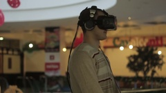 Close-up shot of a man in headphones getting experience in using VR-headset. Stock Footage