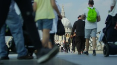 LONDON - Crowd of people crossing the Millennium footbridge Stock Footage