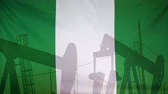 Nigeria flag slow motion oil production concept Stock Footage