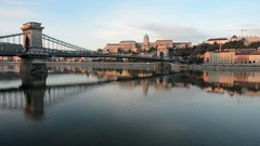 The Chain Bridge is bathed in late day sunlight in Budapest, Hungary Stock Footage