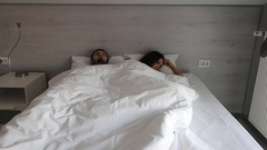 Couple is waking up in the morning with headache. Monday morning of a young Stock Footage