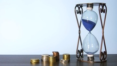 Clock And Stacks Of Coins Stock Footage