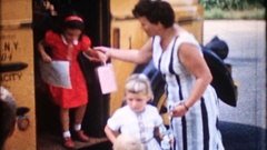 Mom greets the children getting off the school bus, 3857 vintage film home movie Stock Footage