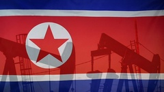 North Korea flag slow motion oil production concept Stock Footage