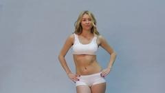 Walking blonde woman Stock Footage