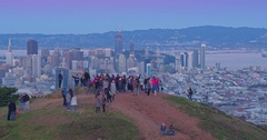 Aerial Shot of tourists san francisco skyline at sunset from Twin Peaks Stock Footage