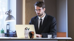 Young Businessman Having a Headache Stock Footage