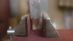 Metall block in vise Stock Footage