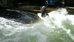 Shot of surfer surfing in Eisbach River in Munich Stock Footage