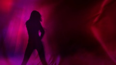 Dancing Female Silhouette Billowing Red Cloth Stock Footage