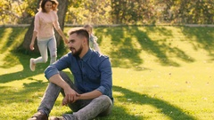Happy family having fun together in nature closing each other is eyes with hands Stock Footage