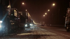 Blizzard at federal route M10 in Novgorod region, Russia. Semitrailers in jam Stock Footage