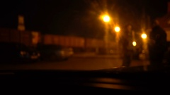 Night industrial zone, railway station full of trains. Shot from a car. Smoothed Stock Footage