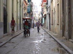 Trishaw rides on a street Stock Footage