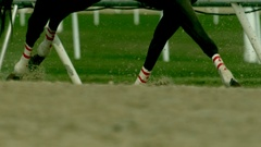 Tight shot of a Horse's Legs While Racing in Slow Motion Stock Footage