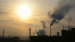 The smoke from the chimneys of factories in miniature effect - Evening sunset Stock Footage