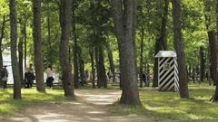 Tourists walk summer in city park of Peterhof, Saint Petersburg Stock Footage