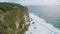 High rocky breakage before the ocean. View from a great height, on the waves Stock Footage