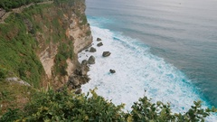 Scenic view of high cliff and deep blue sea at the foot of the rock Stock Footage