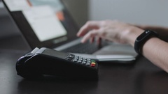 Woman uses credit card terminal in office. Stock Footage