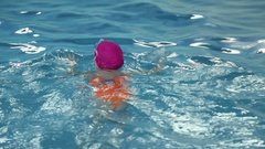 Girl learns to swim Stock Footage