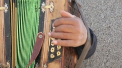 Man aged 60s plays the accordion outdoors Stock Footage