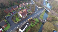 Aerial view of roadworks on a UK housing estate. Stock Footage