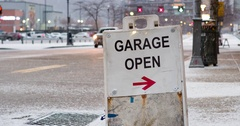 Garage open in winter with traffic going by on street 4k Stock Footage