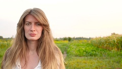 Young woman laughts close-up to camera Stock Footage