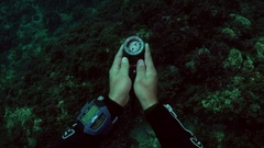 Scuba diver using compass to navigate underwater Stock Footage