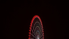 Ferris wheel spinning at night. The magical attraction Stock Footage