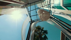 View in a deckchair, blue sky and sun glare palm leaf that kolyshatsya from the Stock Footage
