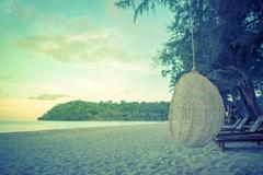 Wooden and robe cradle at sea for relax. Stock Photos