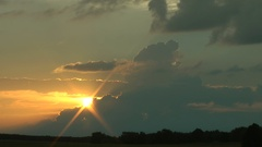Sunset in the evening. Fragmentary clouds. Last beams of the sun. Stock Footage
