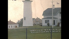 Vintage 16mm film, 1947 Massachusetts USCG Chatham, flags and lighthouse Stock Footage