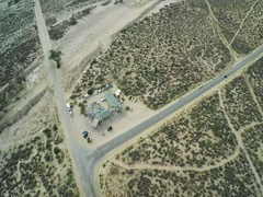 Crossroads in the desert. Aerial view. Car driving along empty countryside road Stock Footage