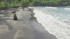 Couple Walking Beautiful Beach Nusa Penida Aerial 4k Stock Footage