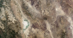 High-altitude overflight aerial of rocky, arid terrain in Mojave Desert, Arizona Stock Footage