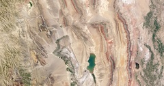 High-altitude overflight aerial, thrust belt rock layers Xinjiang province China Stock Footage