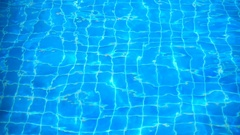 Slow motion of water ripples with see the floor tiles in pool Stock Footage