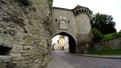 Old city in Tallinn, Estonia. Big Sea gate and tower Fat Margarita Stock Footage